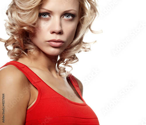 Sexy gorgeous caucasian blonde woman  in red dress
