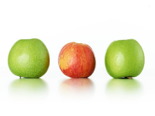 Two fresh, green and one crumpled apple