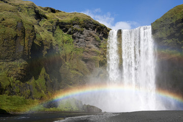 Double rainbow at waterfall Skogafoss, Iceland