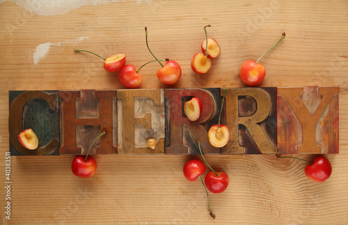 cherries with word in old wood type