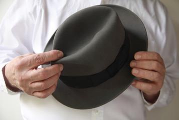 businessman with an old felt hat
