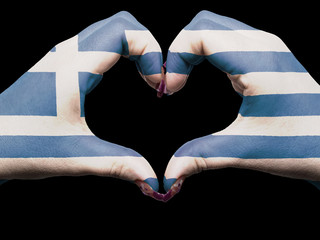 Heart and love gesture by hands colored in greece flag for touri