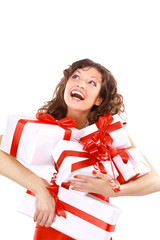Excited attractive woman with many gift boxes and
