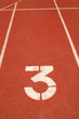 Number 3 on running track