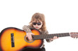 Child playing a guitar