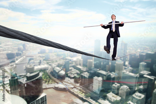 Business man balancing on the rope
