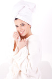 Beautiful healthy young brunette woman in a white spa bath robe