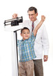 Doctor Weighing Cheering Little Boy on Weight Scale