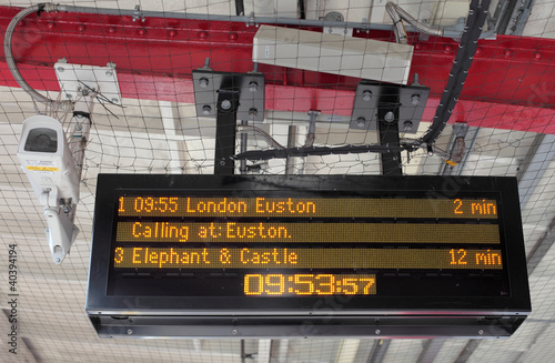 Electronic Timetable on London Railway Platform with Security Ca - 40394194