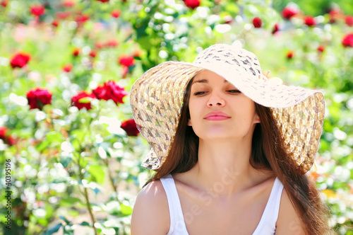 Young woman wearing sun hat