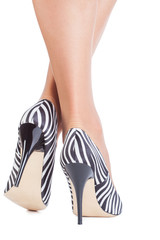 Zebra print shoes on lady isolated on white