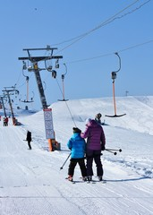 two skiers rising to the point of the start
