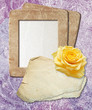 Grunge frame with yellow rose and paper