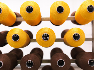 brown and yellow thread reels