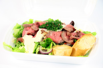 Roastbeef with fresh vegetable salad on white background
