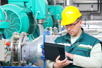 Industrial worker with notebook