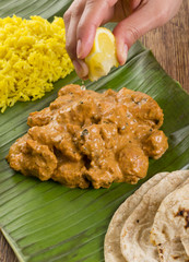Butter Chicken & Lemon Rice -Indian curry on a banana leaf