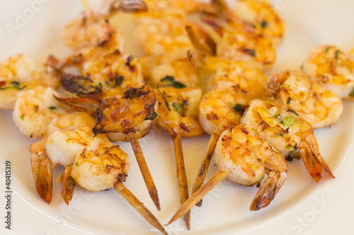 BBQ Prawns - Grilled prawn skewers on a white plate
