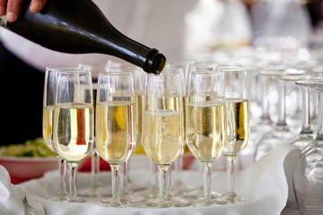 champagne pour into glasses
