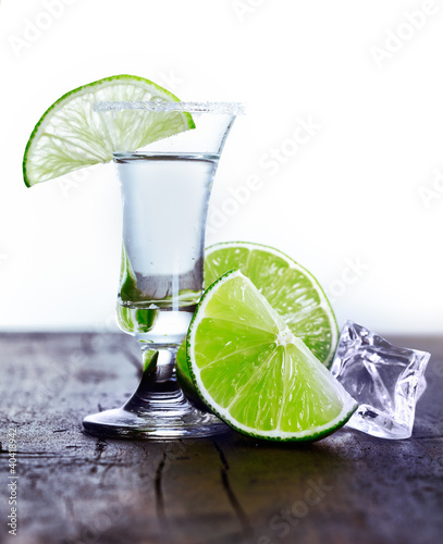 Tall glass with cool drink and lime slice