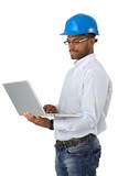 Engineer in hardhat with computer