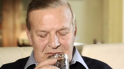 senior man drinking whisky