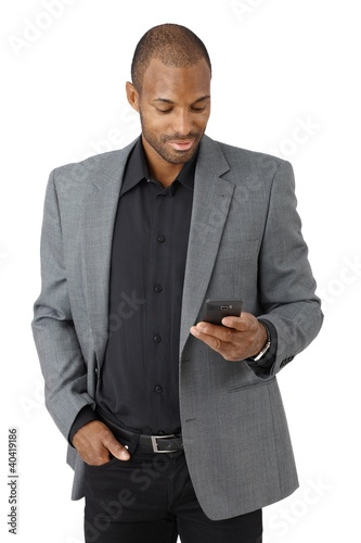 Handsome businessman texting
