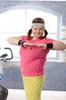 Happy plump woman exercising