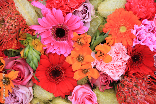 red, pink and orange flower arrangement
