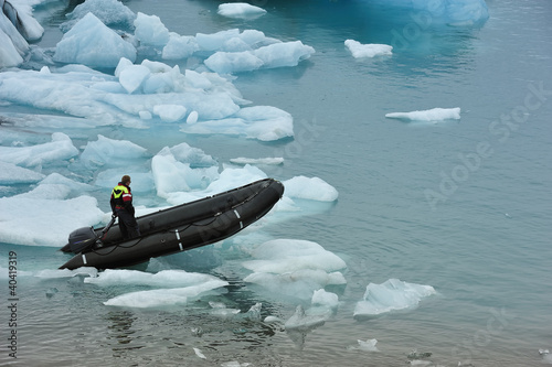 a man on rubber boat on Jokulsarlon Glacier Lake, Iceland