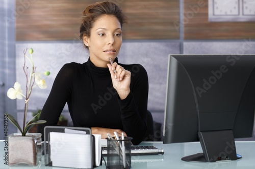 Portrait of attractive working businesswoman