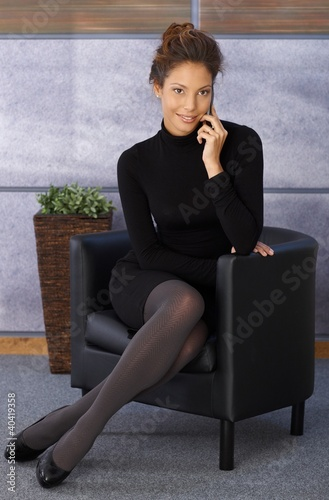 Attractive elegant businesswoman on mobile