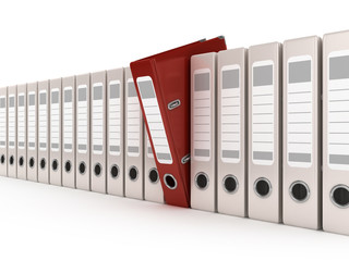 red ring binder standing out from a row of files
