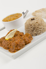 Indian Meat Madras served with pilau rice, tarka dahl & chapatis