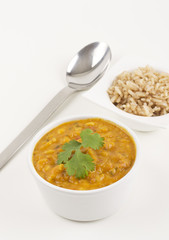 Tarka daal and pilau rice on a white background