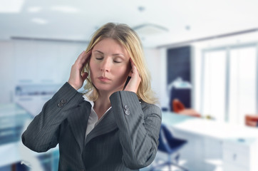 Business woman has headache in the office