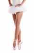 Lower half waist down image of ballerina on pointe