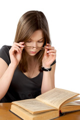 girl with glasses and the open book isolated on a white