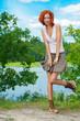 beautiful woman standing near lake