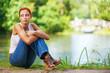 beautiful woman sitting on ground