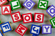 Wooden blocks forming the letters SOS in the center