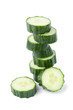Stack of cucumber slices, white background