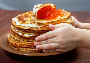 Russian pancakes  with red caviar