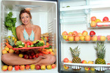 Woman sitting in a fridge