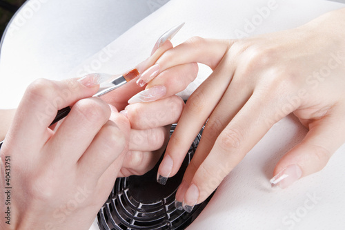Manicure. Master make nail extension