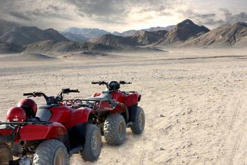 landscape of egyptian desert and all-terrain vehicle