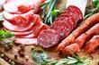 Leinwandbild Motiv Italian ham and salami with herbs