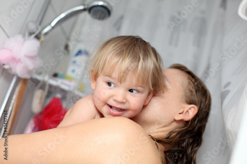 Baby taking a shower with mama