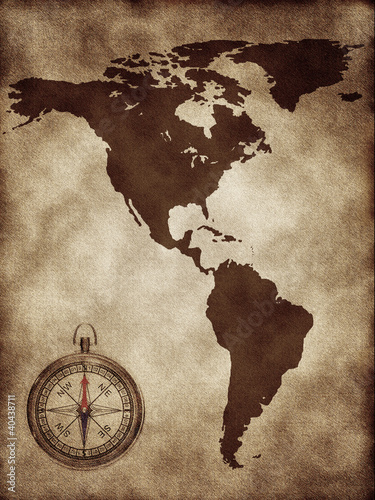 A map with a compass North and South America
