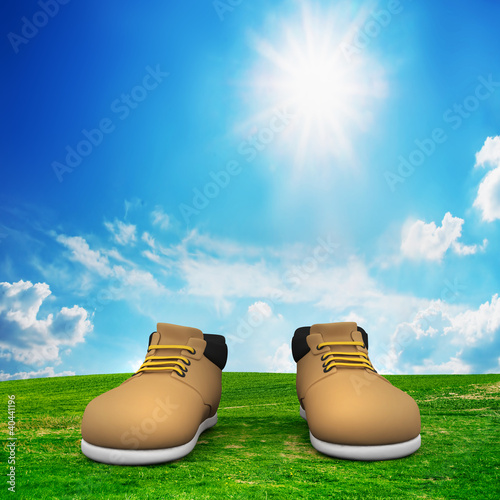 Shoes on green field. Adventure, trip concept